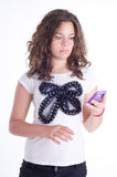 Teenage girl with mobile telephone Stock Photography