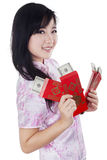 Teenage girl with money dollars cash in envelope Stock Photo