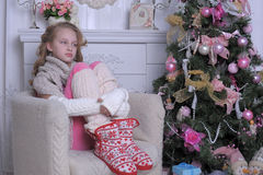 Teenage girl near the Christmas tree Stock Photos