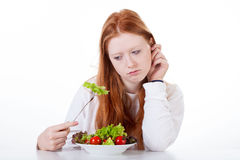 Teenage girl with no appetite. On white isolated background Stock Image