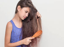 A teenage girl not satisfied with their hair Stock Image