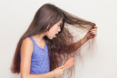 A teenage girl not satisfied with their hair Royalty Free Stock Images