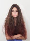 A teenage girl not satisfied with their hair. Portrait of a girl teenager that is not happy with her hair Stock Photos