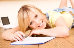Teenage girl with notebook and pen Stock Photo