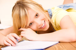 Teenage girl with notebook and pen Stock Photos