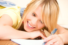 Teenage girl with notebook and pen Royalty Free Stock Photo
