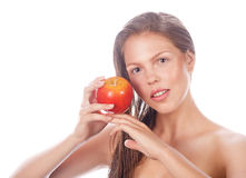 Teenage girl with nude makeup holding red apple. Royalty Free Stock Images