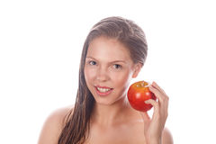 Teenage girl with nude makeup holding red apple. Royalty Free Stock Photography