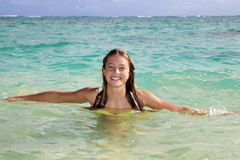 Teenage girl in the ocean in hawaii Stock Images