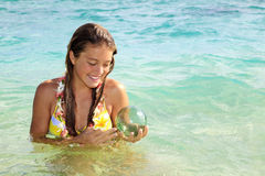 Teenage girl in the ocean in hawaii Stock Photo