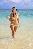 Teenage girl in the ocean in hawaii Stock Photo
