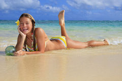 Teenage girl in the ocean in hawaii Royalty Free Stock Image