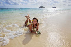 Teenage girl in the ocean in hawaii Stock Photos