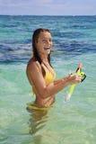 Teenage girl in the ocean in hawaii Stock Images