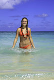 Teenage girl in the ocean in hawaii Stock Image
