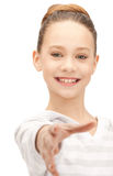 Teenage girl with an open hand ready for handshake Royalty Free Stock Photography