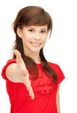 Teenage girl with an open hand ready for handshake Royalty Free Stock Images