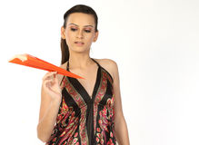Teenage girl with orange paper plane Royalty Free Stock Image