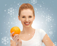 Teenage girl with orange Stock Photo