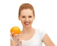 Teenage girl with orange Stock Photography