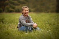 Teenage girl outdoor. In autumn park Stock Images