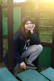 Teenage girl in outdoor gym for public use. Close up sunny photo Royalty Free Stock Photos