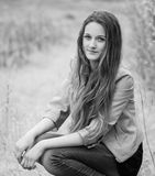 Teenage girl outdoor portrait. Outdoor portrait of beautiful teenage girl in spring in black and white Stock Image
