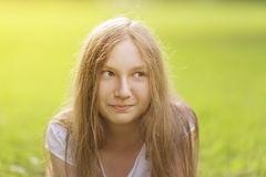 Teenage girl outdoors with playful look Royalty Free Stock Photos