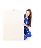 Teenage girl in overalls with blank sign Stock Photos
