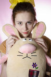 Teenage girl in pajamas with a soft toy Royalty Free Stock Images