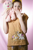 Teenage girl in pajamas with a soft toy Stock Images