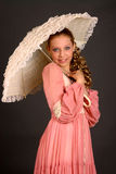 Teenage Girl With Parasol. Blond teenage girl with parasol and wearing period costume dress Stock Images