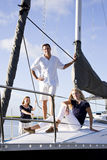Teenage girl and parents on sailboat at dock stock photos