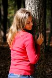 Teenage Girl in the Park. A teenage girl standing against a tree in the park Royalty Free Stock Photo
