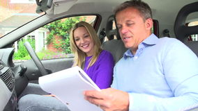 Teenage Girl Passing Driving Test With Examiner Stock Photo