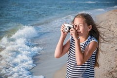 Teenage Girl Photographs on Sea Beach Stock Images