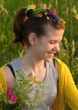 Teenage girl picking flowers on the meadow Royalty Free Stock Photos