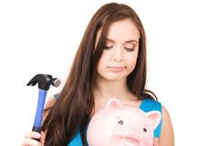 Teenage girl with piggy bank and hammer. Lovely teenage girl with piggy bank and hammer Royalty Free Stock Photos