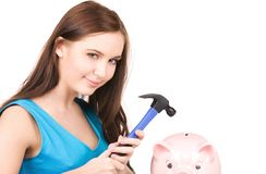 Teenage girl with piggy bank and hammer Stock Image