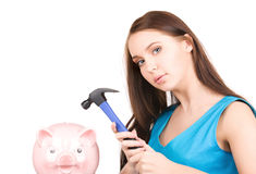 Teenage girl with piggy bank and hammer Stock Photo