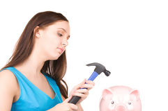 Teenage girl with piggy bank and hammer Royalty Free Stock Images