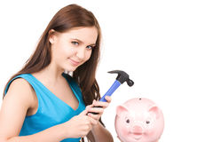 Teenage girl with piggy bank and hammer Stock Images