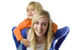 Teenage girl piggybacks a toddler Royalty Free Stock Image