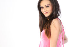 Teenage girl with pink dress Stock Photos