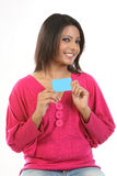 Teenage girl in pink dress with credit card. Young girl in pink dress sitting with credit card Stock Images
