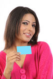 Teenage girl in pink dress with credit card. Young girl in pink dress sitting with credit card Stock Photo
