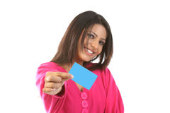 Teenage girl in pink dress with credit card. Young girl in pink dress sitting with credit card Royalty Free Stock Photo