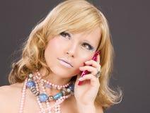 Teenage girl with pink phone Stock Photo