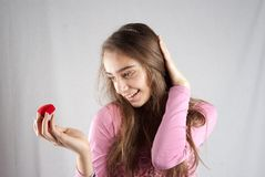 Teenage girl in pink with plush heart Royalty Free Stock Photos