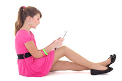 Teenage girl in pink with tablet pc stock photo